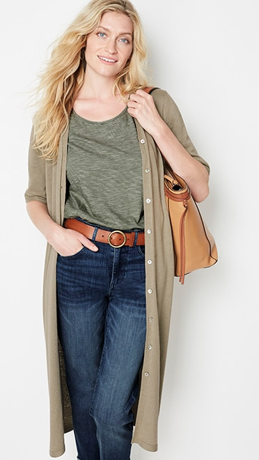 Shop this look—long linen-blend elbow-sleeve cardi, seamed cap-sleeve tee, high-rise cuffed jeans and classic o-ring leather belt