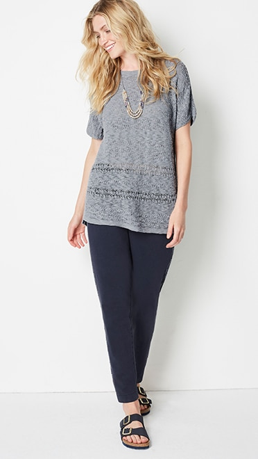 Shop this look—garment-dyed embroidered knit pants, mixed-texture scoop-neck sweater, blue hour layered necklace and Birkenstock® Arizona Soft Footbed Sandals