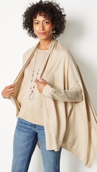 Shop this look—ultra-luxe silk-blend three-way wrap, ultra-luxe silk-blend V-neck sweater, the boyfriend jeans and golden-hour tassel  pendant