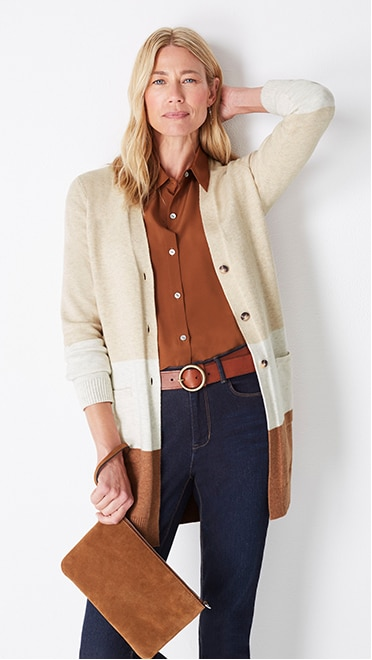 Shop this look—color-block button-front cardi, relaxed washable-silk shirt, high-rise straight-leg jeans, and convertible crossbody bag