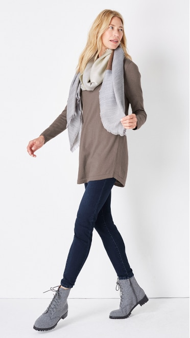 Shop this look—Naomi lace-up boot, highland V-neck sweater tunic, soft ultra stretch denim leggings and double faced fringe trimmed scarf