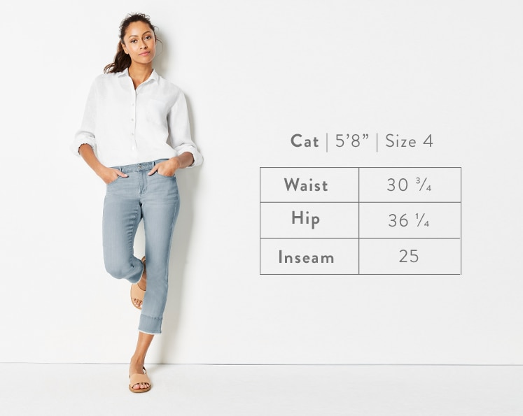 A front-facing photo of Cat modeling Authentic Fit Fringed-Hem Cropped Jeans. Cat is 5 feet 8 inches tall, and a size 4. Waist: 30 3/4 inches, Hip: 36 1/4 inches, Inseam: 25 inches.