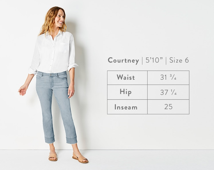 A front-facing photo of Courtney modeling Authentic Fit Fringed-Hem Cropped Jeans. Courtney is 5 feet 10 inches tall, and a size 6. Waist: 31 3/4 inches, Hip: 37 1/4 inches, Inseam: 25 inches.