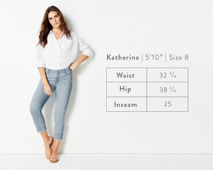 A front-facing photo of Katherine modeling Authentic Fit Fringed-Hem Cropped Jeans. Katherine is 5 feet 10 inches tall, and a size 8. Waist: 32 3/4 inches, Hip: 38 1/4 inches, Inseam: 25 inches.