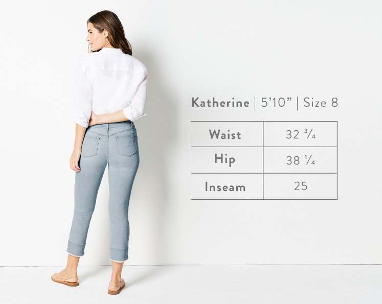 A rear-facing photo of Katherine modeling Authentic Fit Fringed-Hem Cropped Jeans. Katherine is 5 feet 10 inches tall, and a size 8. Waist: 32 3/4 inches, Hip: 38 1/4 inches, Inseam: 25 inches.