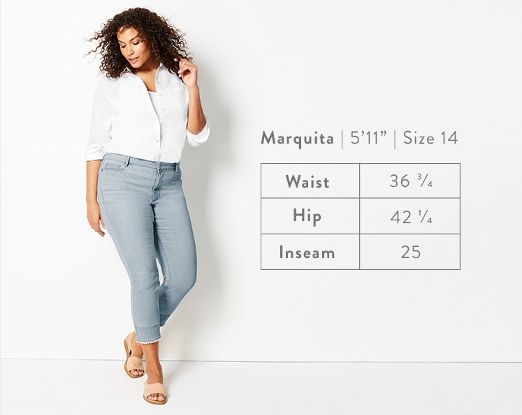 A front-facing photo of Marquita modeling Authentic Fit Fringed-Hem Cropped Jeans. Marquita is 5 feet 11 inches tall, and a size 14. Waist: 36 3/4 inches, Hip: 42 1/4 inches, Inseam: 25 inches.