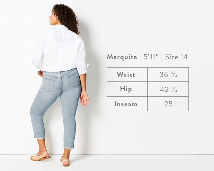 A rear-facing photo of Marquita modeling Authentic Fit Fringed-Hem Cropped Jeans. Marquita is 5 feet 11 inches tall, and a size 14. Waist: 36 3/4 inches, Hip: 42 1/4 inches, Inseam: 25 inches.