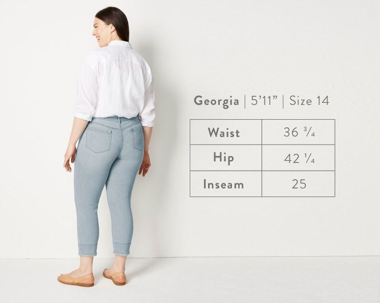 A rear-facing photo of Georgia modeling Authentic Fit Fringed-Hem Cropped Jeans. Georgia is 5 feet 11 inches tall, and a size 14. Waist: 36 3/4 inches, Hip: 42 1/4 inches, Inseam: 25 inches.
