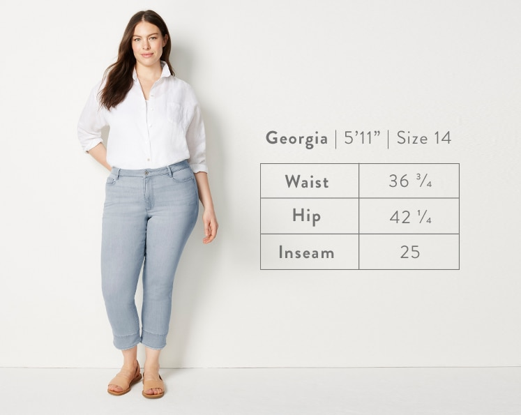 A front-facing photo of Georgia modeling Authentic Fit Fringed-Hem Cropped Jeans. Georgia is 5 feet 11 inches tall, and a size 14. Waist: 36 3/4 inches, Hip: 42 1/4 inches, Inseam: 25 inches.