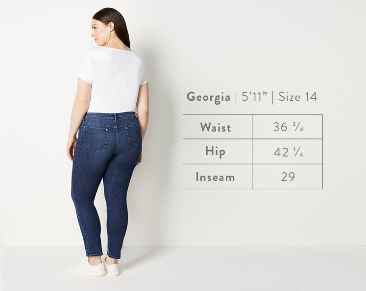 A rear-facing photo of Georgia modeling Authentic Fit Slim-Leg Jeans. Georgia is 5 feet 11 inches tall, and a size 14. Waist: 36 3/4 inches, Hip: 42 1/4 inches, Inseam: 29 inches.