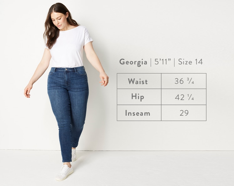 A front-facing photo of Georgia modeling Authentic Fit Slim-Leg Jeans. Georgia is 5 feet 11 inches tall, and a size 14. Waist: 36 3/4 inches, Hip: 42 1/4 inches, Inseam: 29 inches.