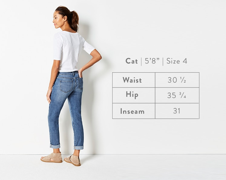 A rear-facing photo of Cat modeling Boyfriend Jeans. Cat is 5 feet 8 inches tall, and a size 4. Waist: 30 1/2 inches, Hip: 35 3/4 inches, Inseam: 31 inches.