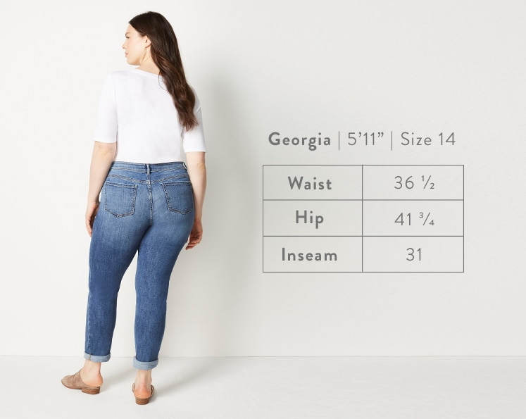 A rear-facing photo of Georgia modeling Boyfriend Jeans. Georgia is 5 feet 11 inches tall, and a size 14. Waist: 36 1/2 inches, Hip: 41 3/4 inches, Inseam: 31 inches.