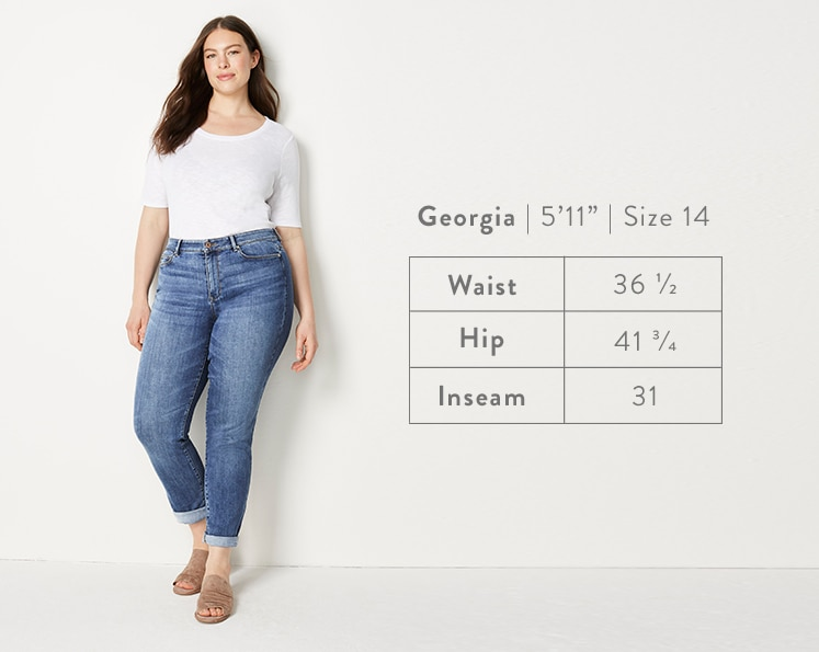 A front-facing photo of Georgia modeling Boyfriend Jeans. Georgia is 5 feet 11 inches tall, and a size 14. Waist: 36 1/2 inches, Hip: 41 3/4 inches, Inseam: 31 inches.