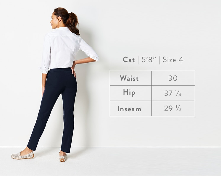 A rear-facing photo of Cat modeling Precision-Stretch Slim-Leg Pants. Cat is 5 feet 8 inches tall, and a size 4. Waist: 30 inches, Hip: 37 1/4 inches, Inseam: 29 1/2 inches.