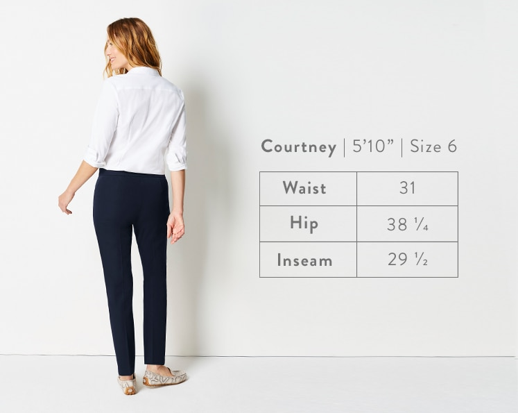 A rear-facing photo of Courtney modeling Precision-Stretch Slim-Leg Pants. Courtney is 5 feet 10 inches tall, and a size 6. Waist: 31 inches, Hip: 38 1/4 inches, Inseam: 29 1/2 inches.