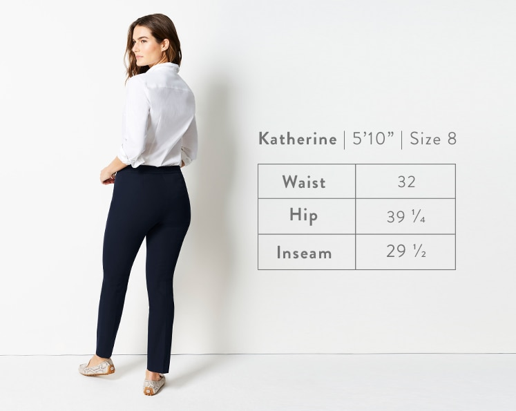 A rear-facing photo of Katherine modeling Precision-Stretch Slim-Leg Pants. Katherine is 5 feet 10 inches tall, and a size 8. Waist: 32 inches, Hip: 39 1/4 inches, Inseam: 29 1/2 inches.
