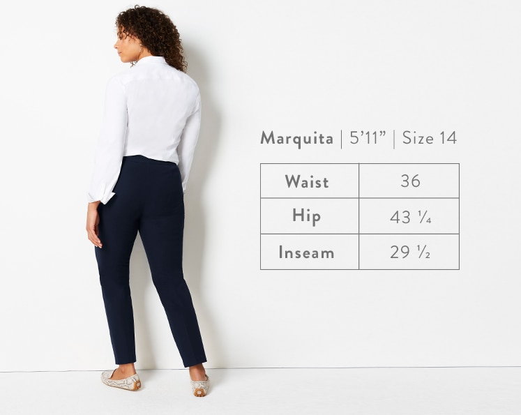 A rear-facing photo of Marquita modeling Precision-Stretch Slim-Leg Pants. Marquita is 5 feet 11 inches tall, and a size 14. Waist: 36 inches, Hip: 43 1/4 inches, Inseam: 29 1/2 inches.