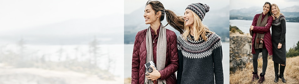 two women standing near a cliff smiling together
